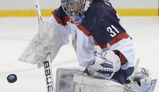 USA Goalkeeper Jessie Vetter blocks a shot on the goal during the second period of the 2014 Winter Olympics women's ice hockey game against Canada at Shayba Arena, Wednesday, Feb. 12, 2014, in Sochi, Russia. (AP Photo/Matt Slocum)