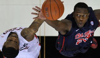 Mississippi center Dwight Coleby (23) and Georgia forward Donte' Williams jump for the ball at the tipoff during an NCAA college basketball game in Athens, Ga., Saturday, Feb. 15, 2014. (AP Photo/Athens Banner-Herald, AJ Reynolds) MAGAZINES OUT; MANDATORY CREDIT