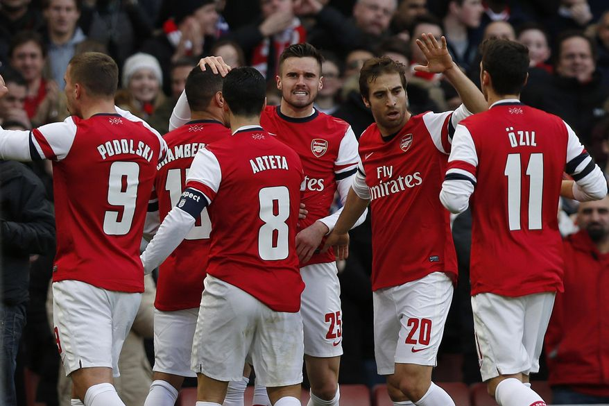 Arsenal's Alex Oxlade-Chamberlain, second left, celebrates his goal against Liverpool with teammates during their English FA Cup fifth round soccer match at Emirates Stadium in London, Sunday, Feb. 16, 2014. (AP Photo/Sang Tan)
