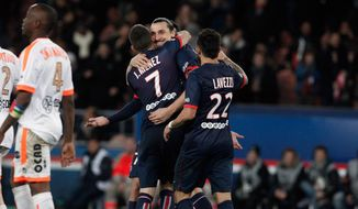 Paris Saint Germain's Zlatan Ibrahimovic, center, celebrates with teammates after scoring a goal, during their French League one soccer match against Valenciennes, at the Parc des Princes stadium, in Paris, Friday, Feb. 14, 2014. (AP Photo/Thibault Camus)