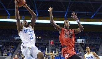 UCLA guard Jordan Adams, left, shoots as Utah guard Delon Wright defends during the first half of an NCAA college basketball game, Saturday, Feb. 15, 2014, in Los Angeles. (AP Photo/Mark J. Terrill)