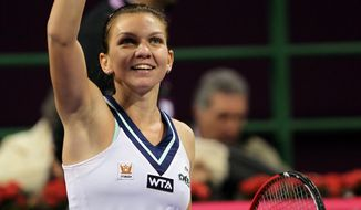 Simona Halep of Romania celebrates as she defeats Poland's Agnieszka Radwanska during the semifinal of the WTA Qatar Ladies Open in Doha, Qatar, Saturday, Feb. 15, 2014. (AP Photo/Osama Faisal