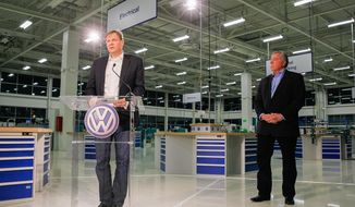 Frank Fischer, the chairman and CEO of the Volkswagen plant in Tennessee, left, and Gary Casteel, a regional director for the United Auto Workers, hold a press conference at the Chattanooga, Tenn., facility on Friday, Feb. 14, 2014, after an announcement that workers at the plant rejected representation of the union. (AP Photo/Erik Schelzig)