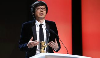 Director Diao Yinan speaks to the audience after receiving the Golden Bear for Best Film for the movie Black Coal, Thin Ice, during the award ceremony at the International Film Festival Berlinale in Berlin, Saturday, Feb. 15, 2014.  (AP Photo/Axel Schmidt)