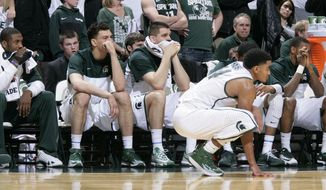 Michigan State players, including, from left to right, Branden Dawson, Gavin Schilling, Alex Gauna, Gary Harris and Keith Appling look on during the closing moments of a 60-51 loss to Nebraska in an NCAA college basketball game on Sunday, Feb. 16, 2014, in East Lansing, Mich. (AP Photo/Al Goldis)