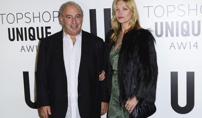 British businessman Sir Philip Green and British model Kate Moss attend the  Topshop Unique collection during London Fashion Week Autumn/Winter 2014, at the Tate Modern in central London, Sunday, Feb. 16, 2014. (Photo by Jonathan Short/Invision/AP)