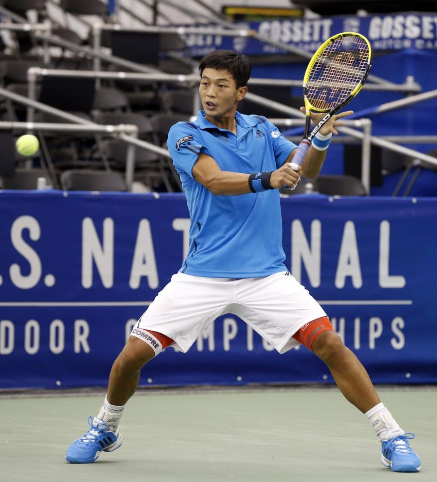 Lu Yen-Hsun, of Taiwan, hits a return to Alex Kuznetsov in the quarterfinals at the U.S. National Indoor Tennis Championships on Friday, Feb. 14, 2014, in Memphis, Tenn. (AP Photo/Rogelio V. Solis)