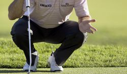 Robert Garrigus eyes what became his birdie putt on the ninth green in the second round of the Northern Trust Open golf tournament at Riviera Country Club in the Pacific Palisades area of Los Angeles, Friday, Feb. 14, 2014.  (AP Photo/Reed Saxon)