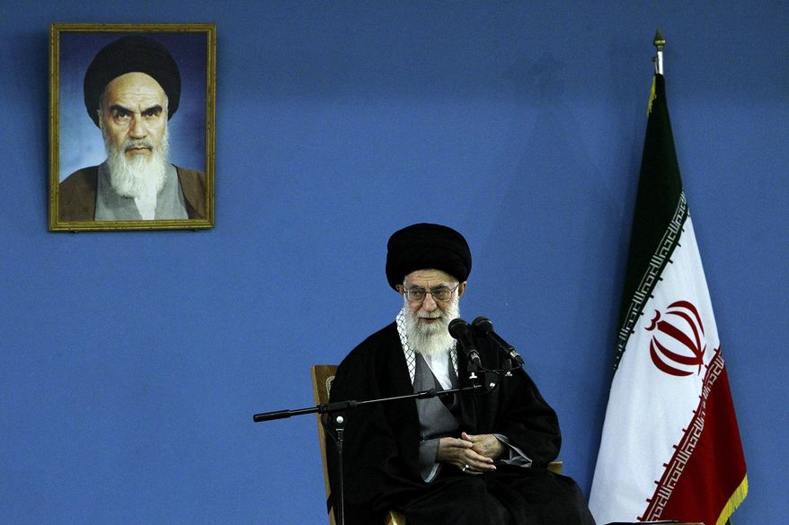 In this picture released by an official website of the office of the Iranian supreme leader, Supreme Leader Ayatollah Ali Khamenei delivers a speech under a picture of the late revolutionary founder Ayatollah Khomeini, in Tehran, Iran, Monday, Feb. 17, 2014. Iran's top leader backs the continuation of nuclear negotiations with the West but says he doubts they will succeed. (AP Photo/Office of the Iranian Supreme Leader)