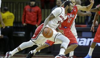 Rutgers forward J.J. Moore (44) dribbles the ball as SMU guard Nick Russell (12) tries to block his path during the first half of an NCAA college basketball game on Friday, Feb. 14, 2014, in Piscataway, N.J. (AP Photo/Mel Evans)