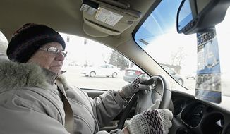 In this Jan . 24, 2014 photo, Dorothy Bierman, 86, makes a right turn while driving in DeKalb, Ill.  (AP Photo/Daily Chronicle, Rob Winner)   **FILE**