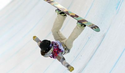 Kelly Clark of the United States falls in her first run during the women's snowboard halfpipe final at the Rosa Khutor Extreme Park, at the 2014 Winter Olympics, Wednesday, Feb. 12, 2014, in Krasnaya Polyana, Russia. (AP Photo/Sergei Grits)