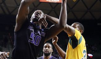 Kansas State forward D.J. Johnson (50) is fouled by Baylor forward Cory Jefferson, right, in the first half of an NCAA college basketball game Saturday, Feb. 15, 2014, in Waco, Texas. (AP Photo/The Waco Tribune-Herald, Rod Aydelotte)