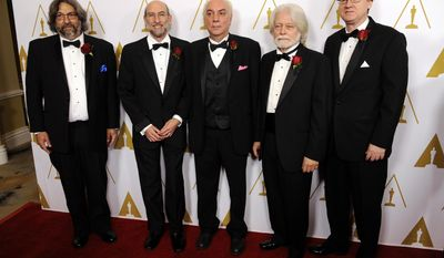 Left to right, Lou Levinson, David Reisner, Joshua Pines, Curtis Clark, ASC, and David Register, developers of the American Society of Cinematographers' Color Decision List technology and recipients of a Technical Achievement Award, pose together at the Academy of Motion Picture Arts and Sciences' annual Scientific and Technical Awards on Saturday, Feb. 15, 2014, in Beverly Hills, Calif. (Photo by Chris Pizzello/Invision/AP)