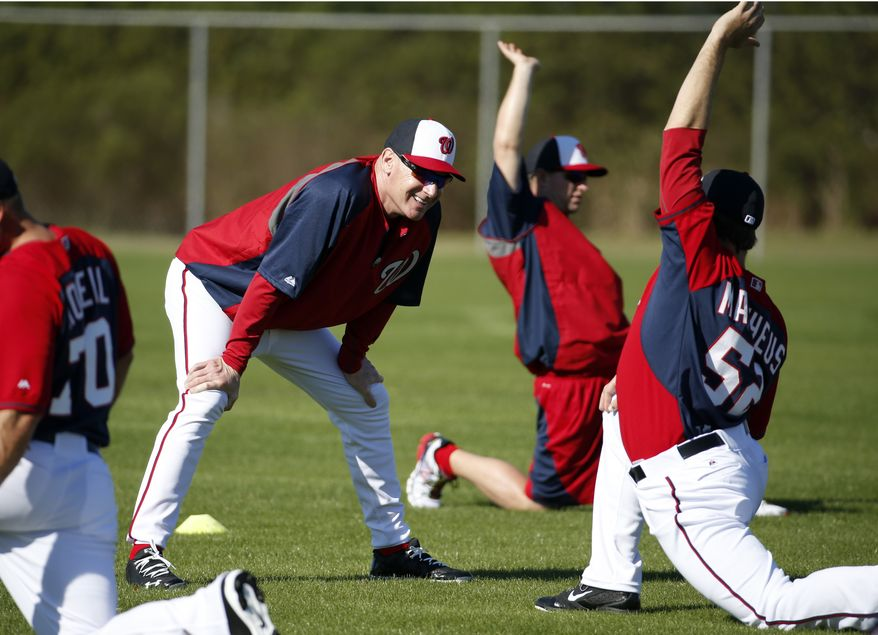 Washington Nationals manager Matt Williams, left, talks with relief pitcher Ryan Mattheus during a spring training baseball workout, Monday, Feb. 17, 2014, in Viera, Fla. (AP Photo/Alex Brandon)