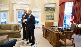 President Obama shows former NBA star Charles Barkley the Oval Office on Feb. 13 after taping an interview with Barkley to air during the weekend's NBA All-Star game. (Pete Souza/White House)
