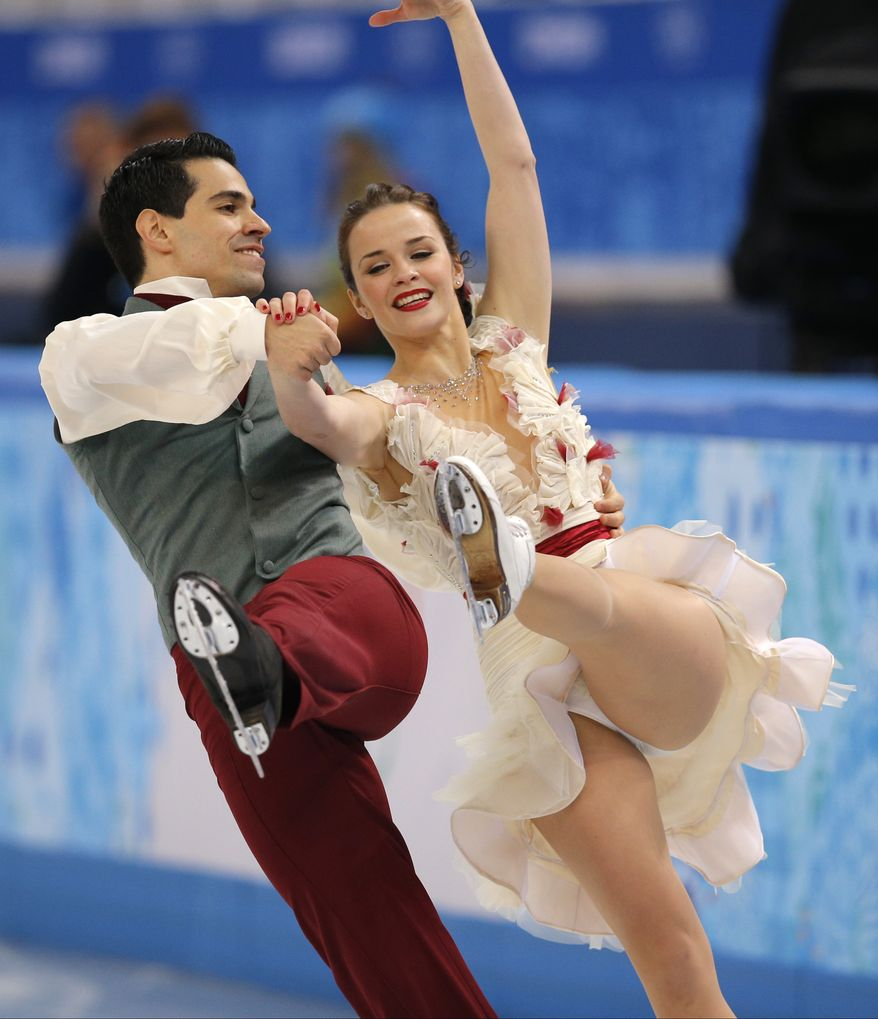 Anna Cappellini and Luca Lanotte of Italy compete in the ice dance free dance figure skating finals at the Iceberg Skating Palace during the 2014 Winter Olympics, Monday, Feb. 17, 2014, in Sochi, Russia. (AP Photo/Vadim Ghirda)