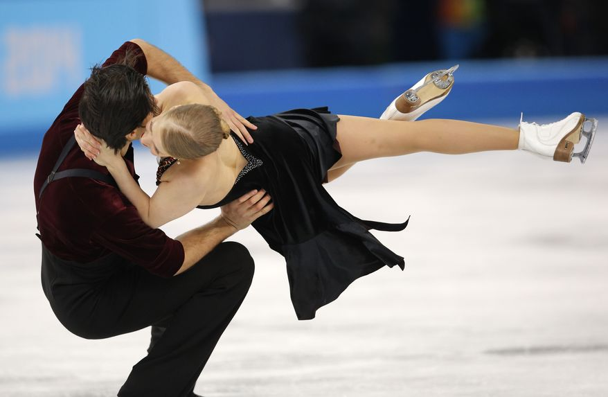 Kaitlyn Weaver and Andrew Poje of Canada compete in the ice dance free dance figure skating finals at the Iceberg Skating Palace during the 2014 Winter Olympics, Monday, Feb. 17, 2014, in Sochi, Russia. (AP Photo/Vadim Ghirda)