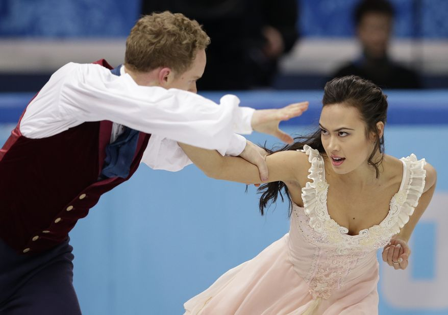 Madison Chock and Evan Bates of the United States compete in the ice dance free dance figure skating finals at the Iceberg Skating Palace during the 2014 Winter Olympics, Monday, Feb. 17, 2014, in Sochi, Russia. (AP Photo/Darron Cummings)