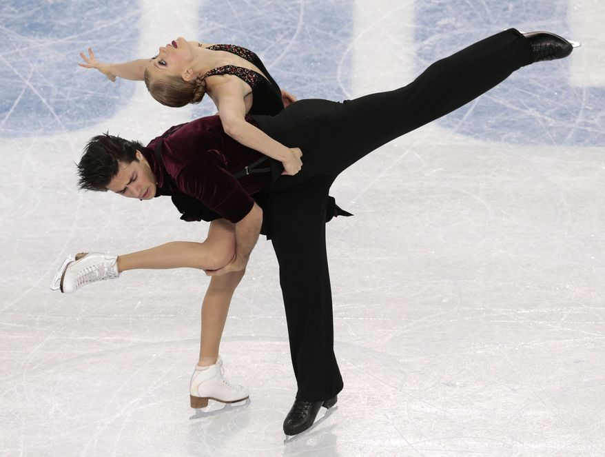 Kaitlyn Weaver and Andrew Poje of Canada compete in the ice dance free dance figure skating finals at the Iceberg Skating Palace during the 2014 Winter Olympics, Monday, Feb. 17, 2014, in Sochi, Russia. (AP Photo/Ivan Sekretarev)