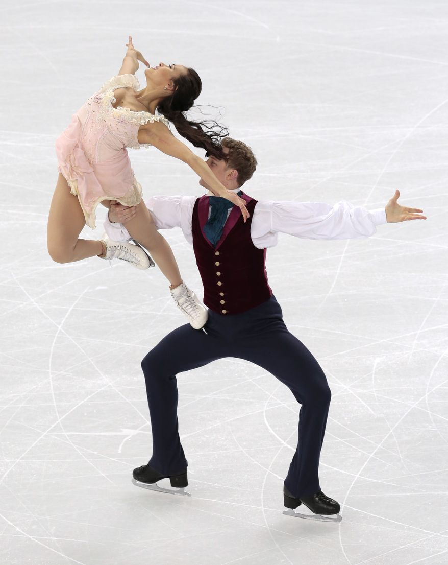 Madison Chock and Evan Bates of the United States compete in the ice dance free dance figure skating finals at the Iceberg Skating Palace during the 2014 Winter Olympics, Monday, Feb. 17, 2014, in Sochi, Russia. (AP Photo/Ivan Sekretarev)