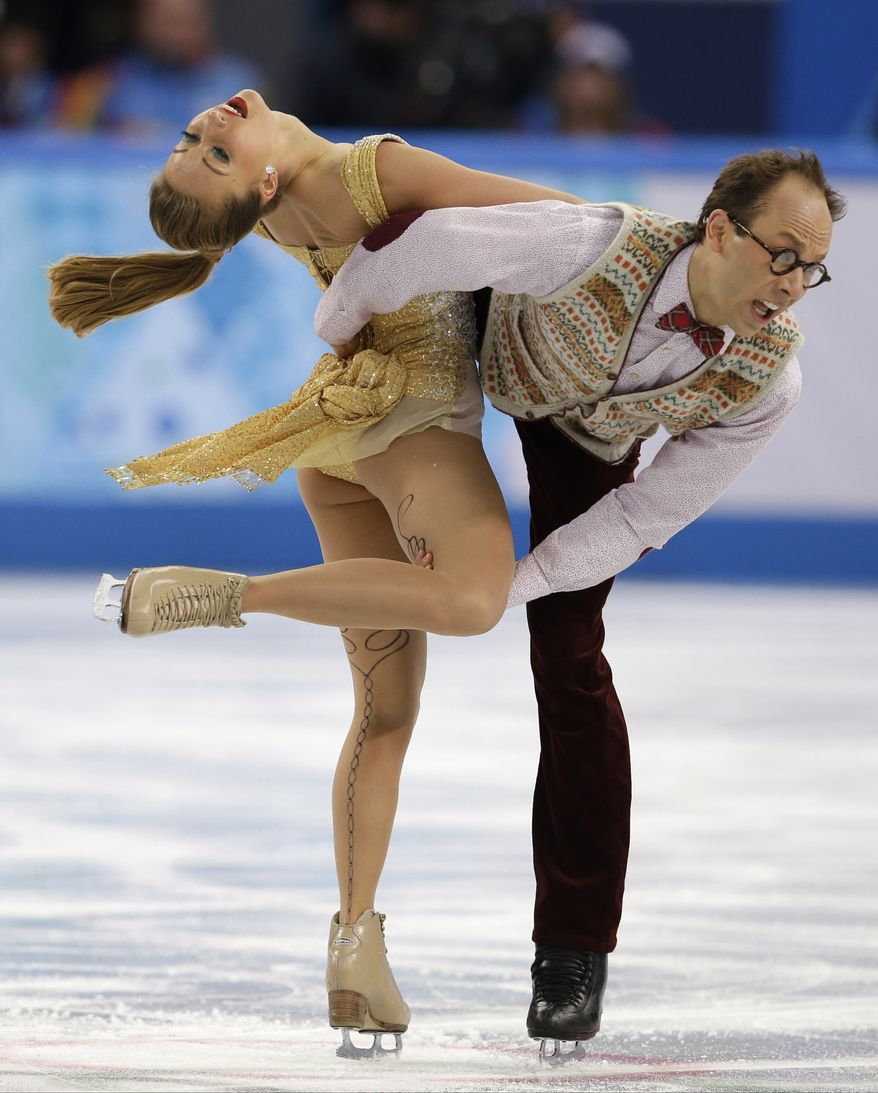 Nelli Zhiganshina and Alexander Gazsi of Germany compete in the ice dance free dance figure skating finals at the Iceberg Skating Palace during the 2014 Winter Olympics, Monday, Feb. 17, 2014, in Sochi, Russia. (AP Photo/Darron Cummings)