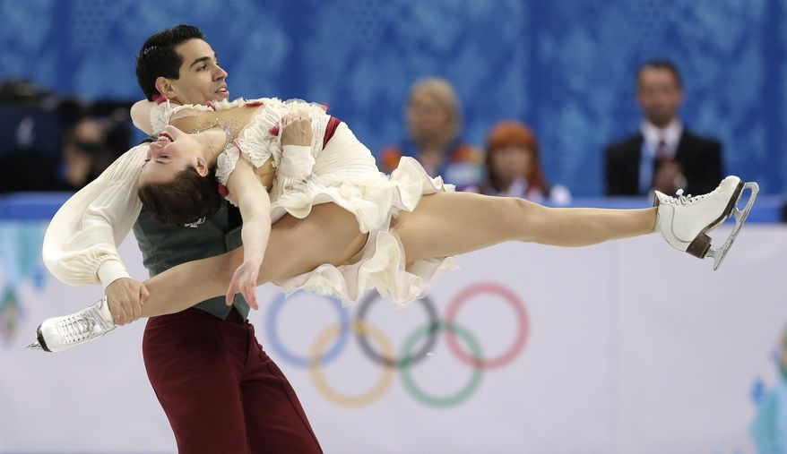 Anna Cappellini and Luca Lanotte of Italy compete in the ice dance free dance figure skating finals at the Iceberg Skating Palace during the 2014 Winter Olympics, Monday, Feb. 17, 2014, in Sochi, Russia. (AP Photo/Darron Cummings)