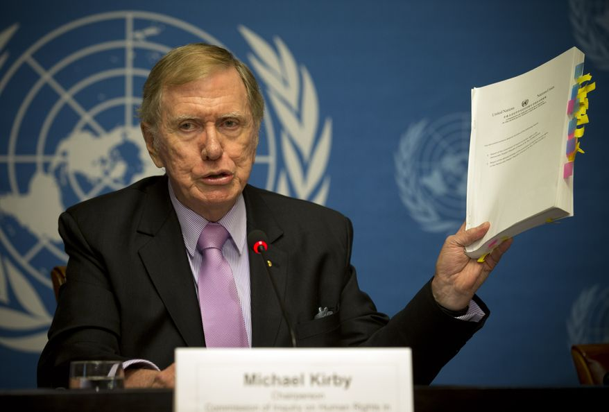 """Retired Australian judge Michael Kirby, chairperson of the commission of Inquiry on Human Rights in the Democratic People's Republic of Korea, shows the commission's report during a press conference at the United Nations in Geneva, Switzerland, Monday, Feb. 17, 2014. A U.N. panel has warned North Korean leader Kim Jong Un that he may be held accountable for orchestrating widespread crimes against civilians in the secretive Asian nation. Kirby told the leader in a letter accompanying a yearlong investigative report on North Korea that international prosecution is needed """"to render accountable all those, including possibly yourself, who may be responsible for crimes against humanity."""" (AP Photo/Anja Niedringhaus)"""