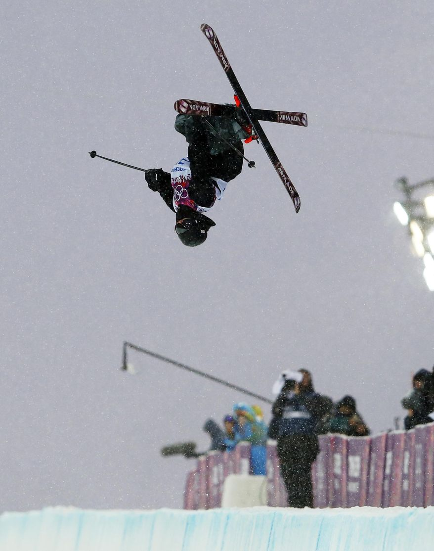 Adam Crook of the British Virgin Islands gets air during men's ski half pipe qualifying at the Rosa Khutor Extreme Park, at the 2014 Winter Olympics, Tuesday, Feb. 18, 2014, in Krasnaya Polyana, Russia. (AP Photo/Sergei Grits)