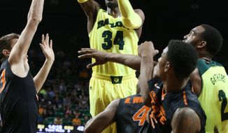 Baylor forward Cory Jefferson (34) scores past Oklahoma State forward/center Mason Cox (53), left, and other players in the second half of an NCAA college basketball game, Monday, Feb. 17, 2014, in Waco, Texas. Baylor won in overtime 70-64. (AP Photo/Waco Tribune Herald, Rod Aydelotte)