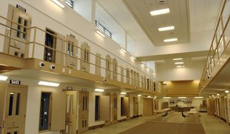 FILE - This June 2013 file photo shows one of the new cell blocks of the North Dakota State Penitentiary in Bismarck, N.D.  Department of Corrections and Rehabilitation officials hope to start using the new facilities by July, 2013. North Dakota's robust economy has led to a record population, the lowest unemployment rate in the nation and thousands of more jobs than takers. But the state's economic miracle led by its oil bonanza also has resulted in plenty of problems, including more crime and increasingly overcrowded prison and jail cells. A state commission made up of lawmakers, judges, lawyers and law enforcement officials is looking for ways to free up limited lockup space without compromising public safety. (AP Photo/Bismarck Tribune, Will Kincaid, File)