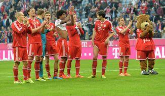 Bayern's players celebrates to supporters after the German first division Bundesliga soccer match between FC Bayern Munich and SC Freiburg in Munich, Germany, on Saturday, Feb. 15, 2014. Bayern won 4-0. (AP Photo/Kerstin Joensson)
