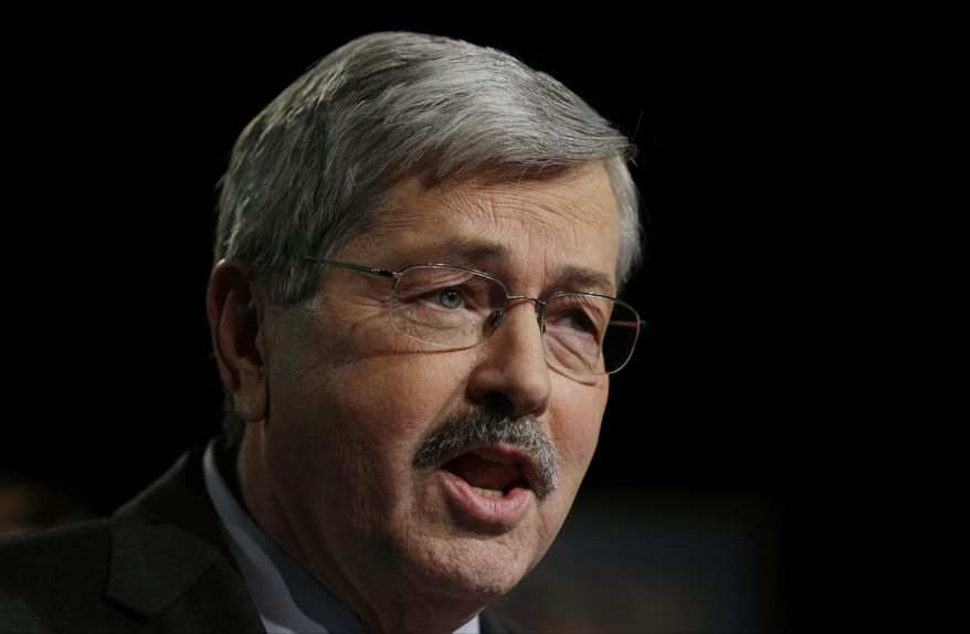 FILE - In this Jan. 15, 2014 file photo is Republican Iowa Gov. Terry Branstad in West Des Moines, Iowa. Iowa's GOP-led House and the Democratic-controlled Senate put Branstad personally in charge of signing off on any payments for publicly funded abortions. About seven months later Branstad hasn't approved any payments but patients eligible for Medicaid-funded abortions received them anyway because the University of Iowa Hospitals and Clinics simply decided not to bill the state for the procedures. (AP Photo/Charlie Neibergall, File)