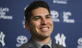 FILE - This Dec. 13, 2013 file photo shows Jacoby Ellsbury during a news conference at Yankee Stadium in New York. Ellsbury reported to the Yankees a day early, Tuesday, Feb. 18, 2014, and looks forward to combining with Brett Gardner in what figures to be the speediest outfield in the major leagues. (AP Photo/John Minchillo, file)