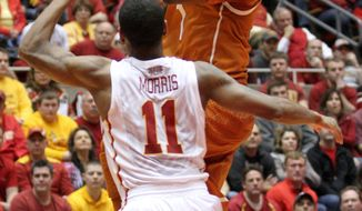 Texas guard Isaiah Taylor goes up for a shot over Iowa State guard Monte Morris during the second half of an NCAA college basketball game at Hilton Coliseum in Ames, Iowa, Tuesday, Feb. 18, 2014. Iowa State won 85-76. (AP Photo/Justin Hayworth)