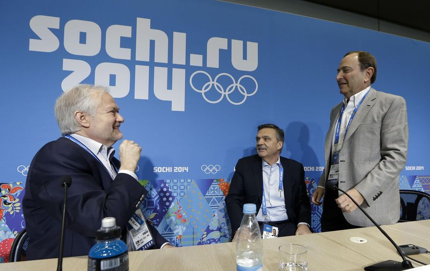 NHL Players' Association Executive Director Don Fehr, left, International Ice Hockey Federation President Rene Fasel, center, and NHL Commissioner Gary Bettman, right, talk following a news conference at the 2014 Winter Olympics, Tuesday, Feb. 18, 2014, in Sochi, Russia. (AP Photo/Mark Humphrey)