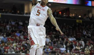 Maryland guard Nick Faust (5) dunks against Wake Forest's Codi Miller-McIntyre (0) during the second half of an NCAA college basketball game, Tuesday, Feb. 18, 2014, in College Park, Md. Maryland won 71-60. (AP Photo/Nick Wass)