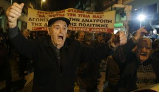 Elderly men shout slogans during a protest outside Health Ministry in Athens on Tuesday, Feb. 18, 2014. Several thousand supporters of a Communist labor union marched in central Athens Tuesday to protest an overhaul of the country's national health system that has led to months of strikes. The government has ordered a shake up of the main health care fund EOPYY, stopping the agency's direct involvement on care provision. The changes were introduced as part of the country's bailout commitments. (AP Photo/Thanassis Stavrakis)
