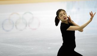 Yuna Kim of South Korea performs during the practice session at Iceberg Skating Palace at the 2014 Winter Olympics, Tuesday, Feb. 18, 2014, in Sochi, Russia. (AP Photo/David Goldman)