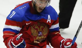 Russia forward Ilya Kovalchuk reacts after Kovalchuk scoring a goal against Norway in the second period of a men's ice hockey game at the 2014 Winter Olympics, Tuesday, Feb. 18, 2014, in Sochi, Russia. (AP Photo/Julio Cortez)