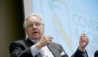 Philanthropist Howard G. Buffett, son of investor Warren Buffett, participates in a panel discussion at the conference on cover crops and soil health, in Omaha, Neb., Tuesday, Feb. 18, 2014. Buffett is sponsoring a national invitation-only conference on the benefits of cover crops in Omaha to get American farmers interested in keeping their soil healthy. (AP Photo/Nati Harnik)