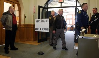 Law enforcement personnel enter the courtroom as John Knysz, far left, waits outside during the jury selection at his son, Eric John Knysz's trial in Mason County's 51st Circuit Court in Ludington, Mich., on Tuesday, Feb. 18, 2014.  Eric Knysz is charged with murder in the shooting death of Michigan State Police Trooper Paul K. Butterfield II on Sept. 9, 2013, during a routine traffic stop.   (AP Photo/The Muskegon Chronicle, Ken Stevens) ALL LOCAL TV OUT; LOCAL TV INTERNET OUT