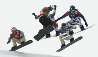 United States' Trevor Jacob, from left, Spain's Lucas Eguibar, Canada's Kevin Hill, United States' Alex Deibold, and Russia's Nikolay Olyunin compete during the men's snowboard cross semifinal at the Rosa Khutor Extreme Park, at the 2014 Winter Olympics, Tuesday, Feb. 18, 2014, in Krasnaya Polyana, Russia. (AP Photo/Jae C. Hong)