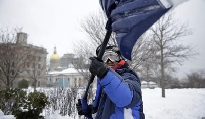 Associated Press photo of a man shoveling.