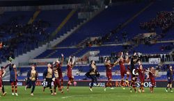 AS Roma players celebrate at the end of a Serie A soccer match between AS Roma and Sampdoria, at Rome's Olympic stadium, Sunday, Feb. 16, 2014. AS Roma won 3-0. (AP Photo/Riccardo De Luca)