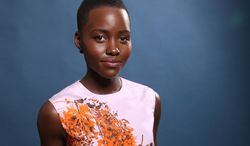 """FILE - In this Monday, Feb. 10, 2014 file photo, Lupita Nyong'o poses for a portrait at the 86th Oscars Nominees Luncheon, in Beverly Hills, Calif. Nyong'o is nominated for an Oscar for her performance by an actress in a supporting role for the film, """"12 Years a Slave."""" The Academy Awards will be held on Sunday, March 2, 2014. (Photo by Matt Sayles/Invision/AP, file)"""