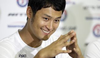 Texas Rangers' Yu Darvish, of Japan, smiles after responding to a question at a news conference during spring training baseball practice, Tuesday, Feb. 18, 2014, in Surprise, Ariz. (AP Photo/Tony Gutierrez)