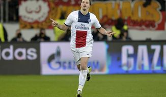 PSG's Zlatan Ibrahimovic celebrates his side's third goal during a Champions League round of the last 16 first leg soccer match between Bayer Leverkusen and Paris Saint-Germain in Leverkusen, Germany, Tuesday Feb. 18, 2014.  (AP Photo/Martin Meissner)
