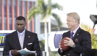 CBS analysts Shannon Sharpe, left, and Boomer Esiason, right, are seen before the NFL Super Bowl XLIV football game between the Indianapolis Colts and New Orleans Saints in Miami, Sunday, Feb. 7, 2010. (AP Photo/Paul Sancya)
