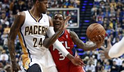 Indiana Pacers forward Paul George (24) fouls Atlanta Hawks guard Louis Williams as Williams dribbles the basketball during the first half of an NBA basketball game in Indianapolis, Tuesday, Feb. 18, 2014. (AP Photo/R Brent Smith)